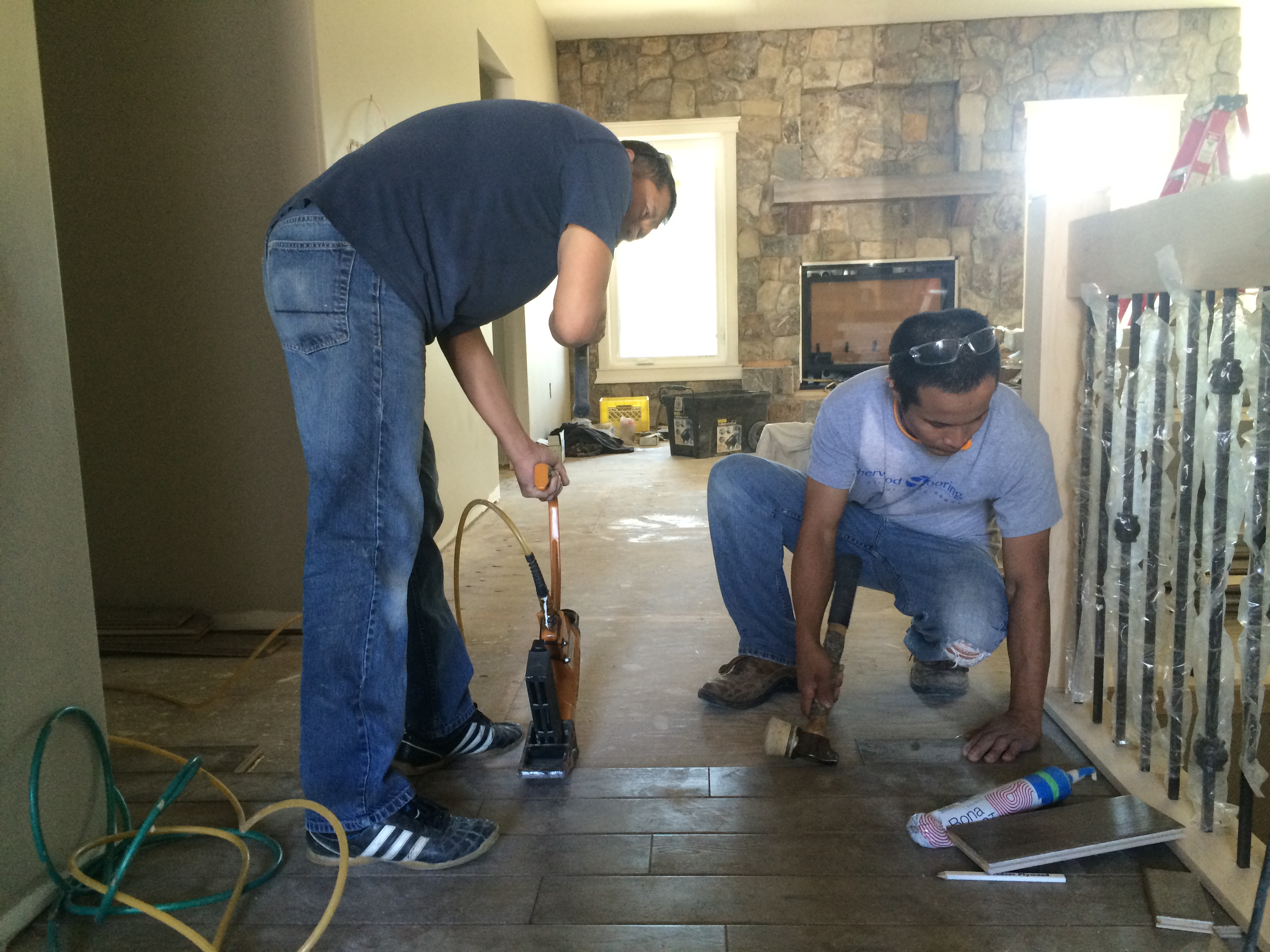 Contractors installing Sherwood Flooring products in living room