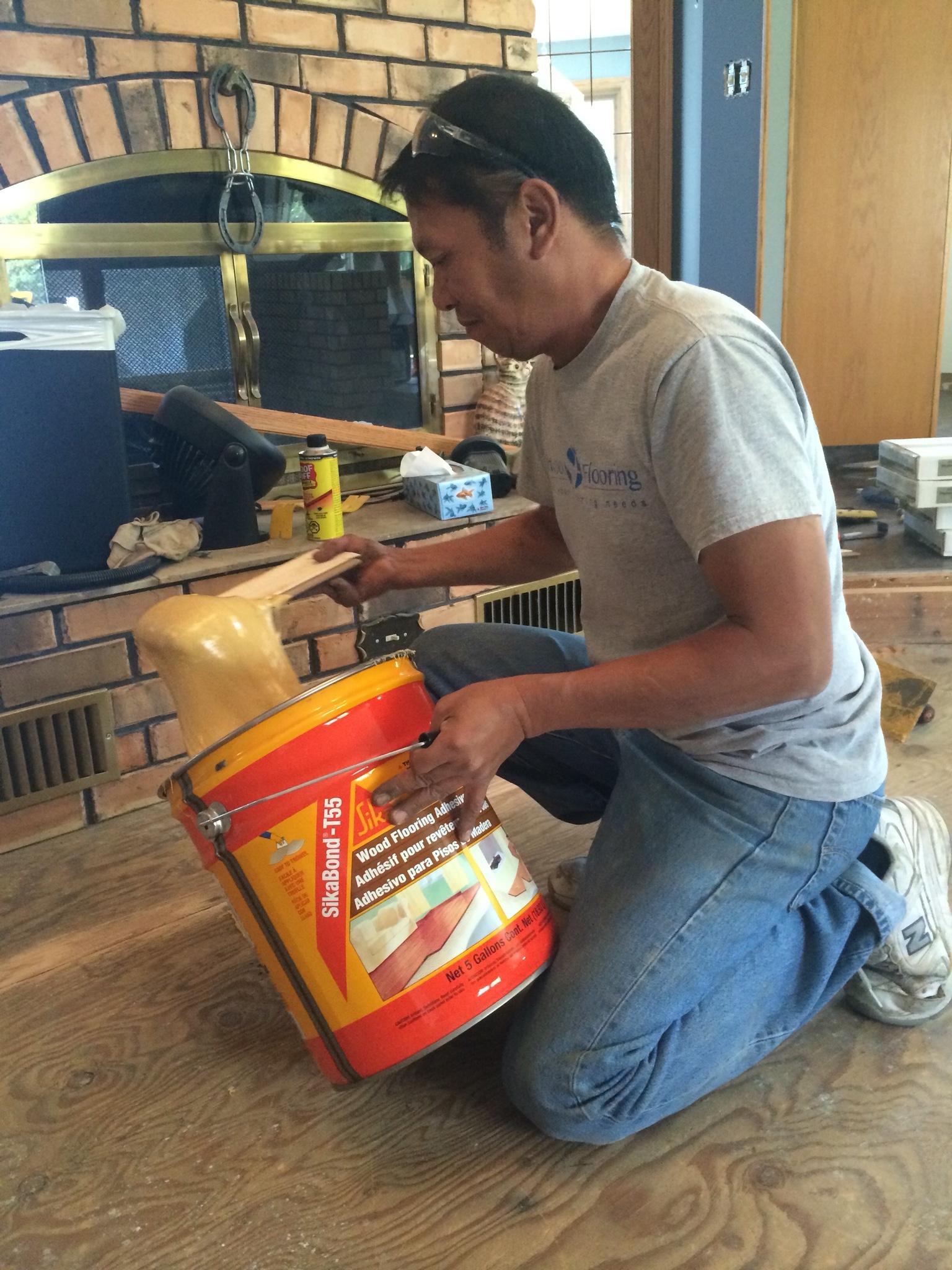 Contractor preparing floor for new product Sherwood Flooring