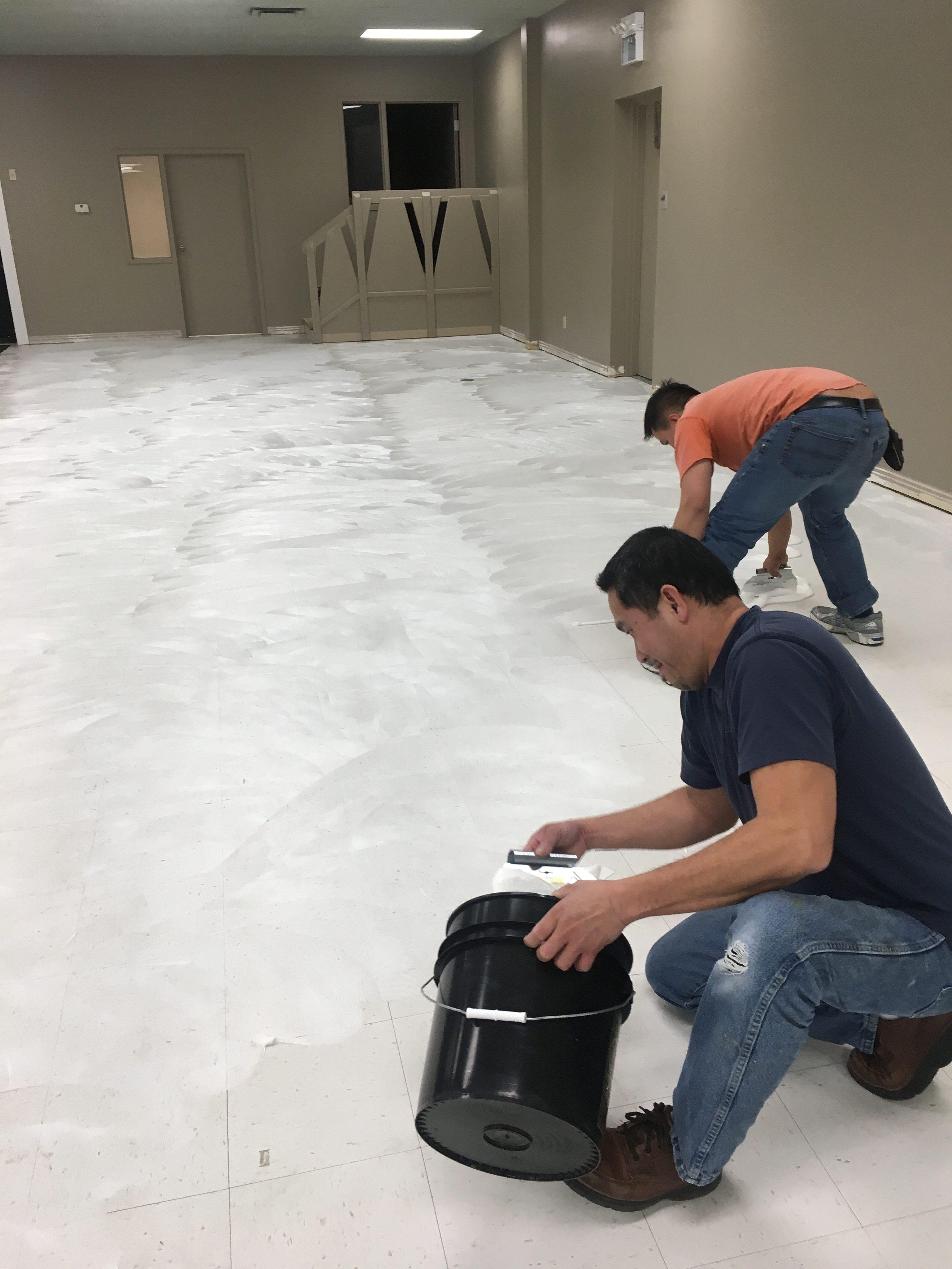 Contractors mudding concrete floor